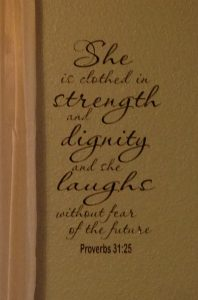She is clothed in strength and dignity wall decor photo